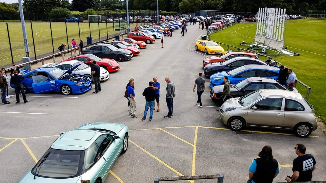 A photo of Cars and Coffee Cheshire earlier this year at Chester County Officers Cricket Club